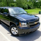 Parked Chevrolet Suburban executive SUV from Echo Limousine in Chicago, IL