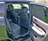 Right side view of Lincoln town car backseat with door open from Echo Limousine in Chicago, IL