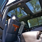 Side view of open door into backseat of Lincoln town car from Echo Limousine in Chicago, IL