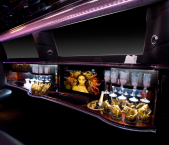 Stretch limo interior with television and bar from Echo Limousine in Chicago, IL