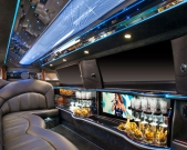 View of fiber optic bar and mood lighting in Lincoln strech limo from Echo Limousine in Chicago, IL