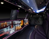 Fiber optic lit bar and television set in Lincoln stretch limo from Echo Limousine in Chicago, IL