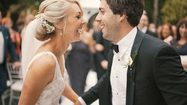 Smiling couple after their wedding in Chicago, IL