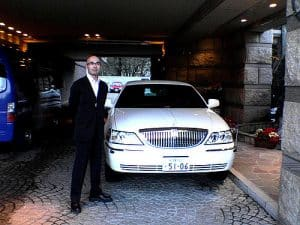 An image of a car service limousine driver.