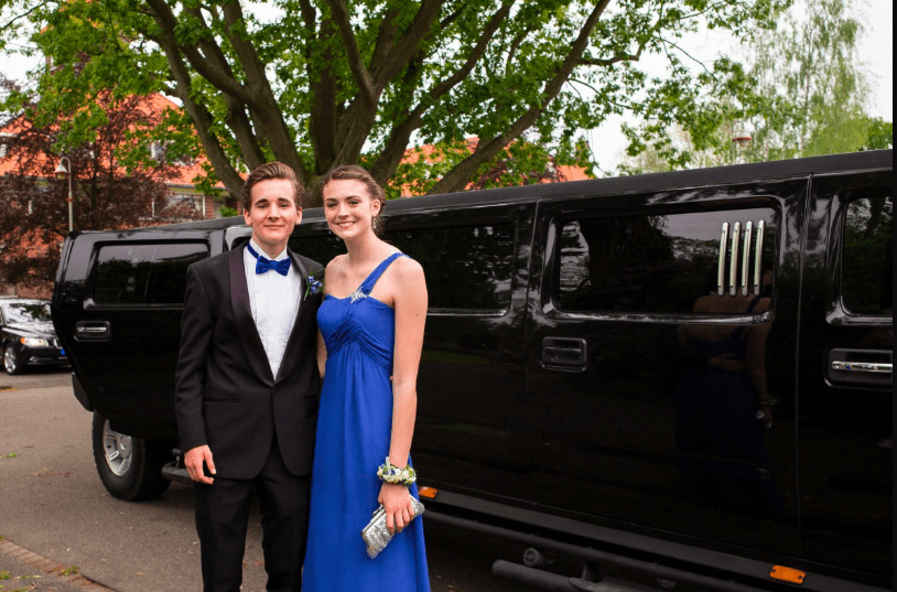 Couple preparing to enter a limo on their way to prom