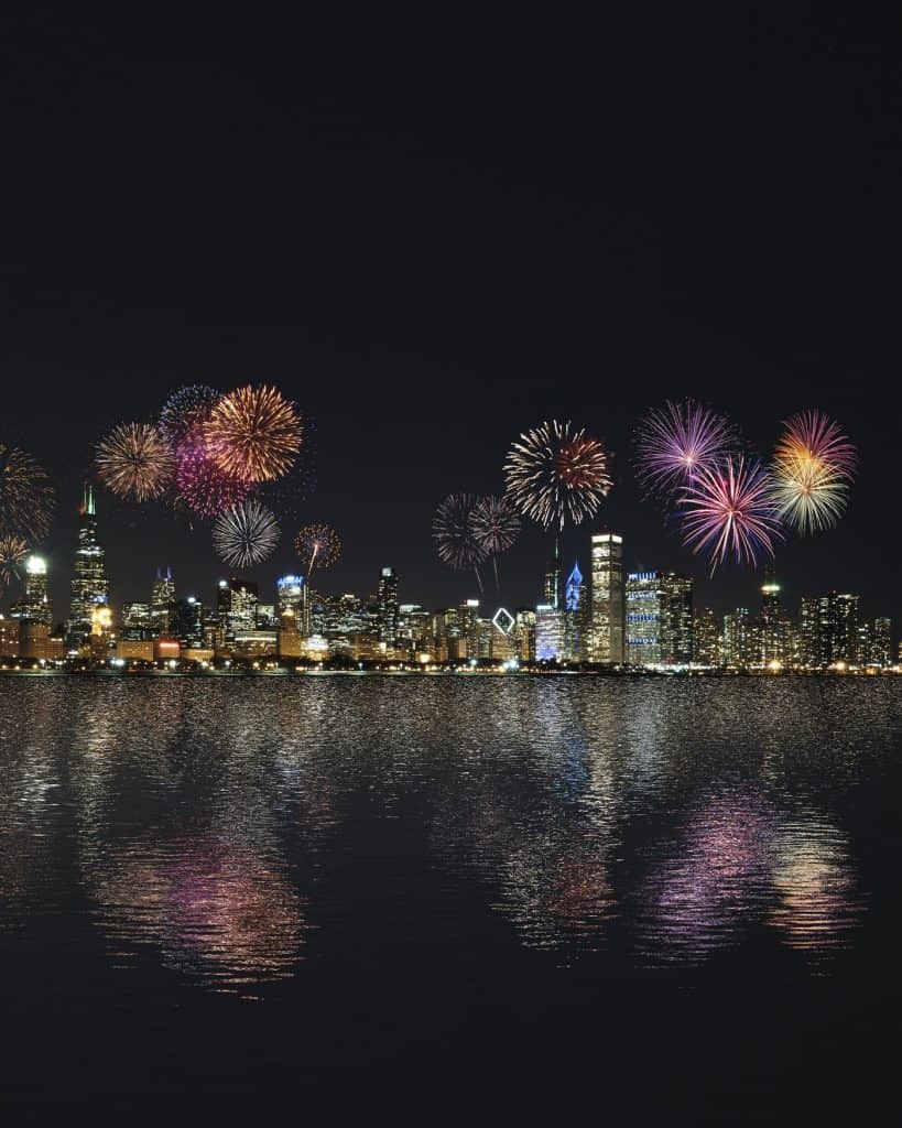 A city shoreline all lit up with fireworks